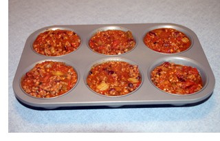 Chili portioned in one-cup muffin tin